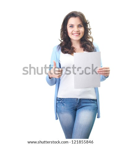 Attractive smiling young woman in a blue shirt holding in her left hand poster, and her right hand showing thumbs up. Isolated on white background
