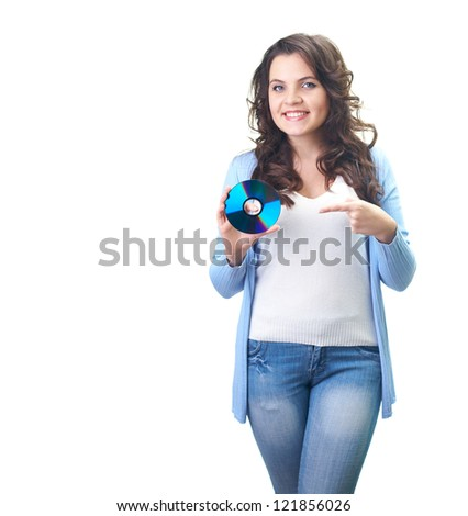 Attractive smiling young woman in a blue shirt holding in her right hand disk and her left hand points to him. Isolated on white background