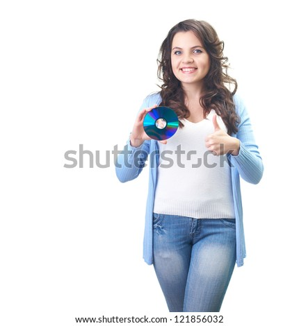 Attractive smiling young woman in a blue shirt holding in her right hand disk and her left hand showing thumbs up. Isolated on white background - stock photo