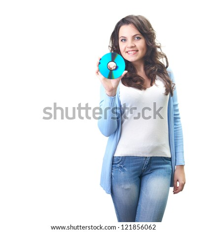 Attractive smiling young woman in a blue shirt holding in her right hand disk. Isolated on white background
