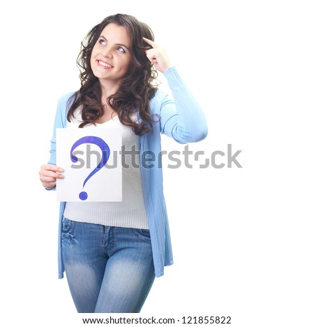 Attractive smiling young woman in a blue shirt holding poster with a big question mark, and looks to the upper-right corner. Isolated on white background