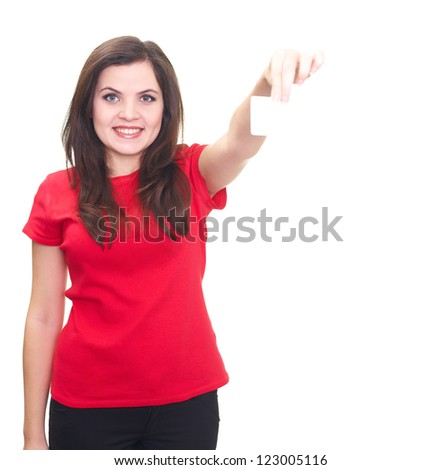 Attractive smiling young woman in a red shirt holding in her left hand poster. Isolated on white background