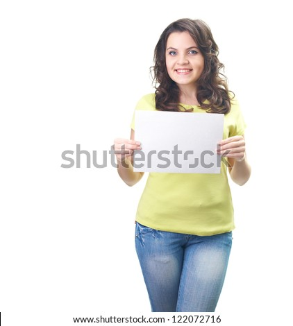 Attractive smiling young woman in a yellow shirt holding a poster. Isolated on white background - stock photo