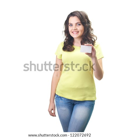 Attractive smiling young woman in a yellow shirt holding in her left hand poster. Isolated on white background - stock photo