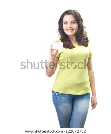 Attractive smiling young woman in a yellow shirt holding in her right hand poster. Isolated on white background - stock photo