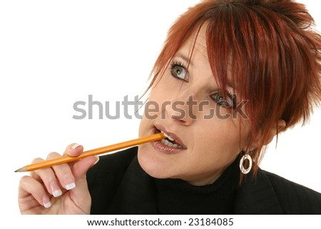 Attractive 30 something red head thinking. - stock photo