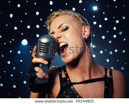 Attractive steampunk girl singing - stock photo
