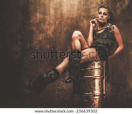Attractive steampunk girl sitting on barrel - stock photo