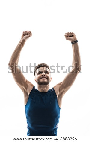 Attractive strong athlete is celebrating his triumph - stock photo
