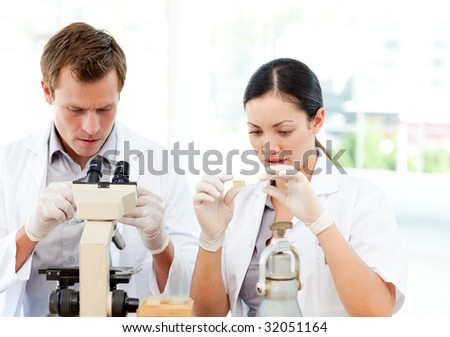Attractive students of science working in a laboratory