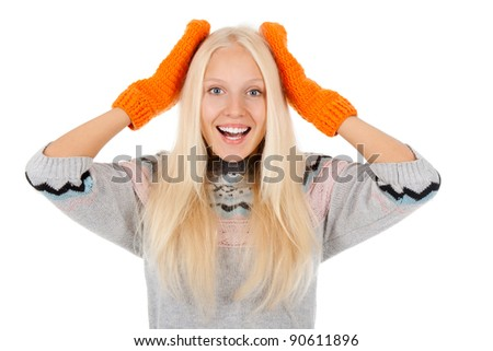 attractive surprised excited smile woman looking at camera holding hands on head, wear winter knitted sweater and orange gloves, isolated over white background - stock photo