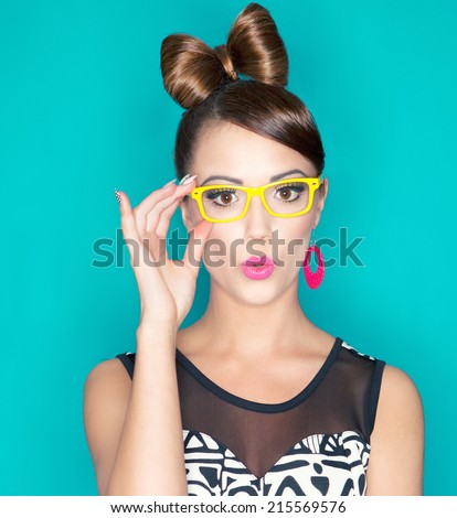 Attractive surprised young woman wearing glasses, beauty and fashion concept  - stock photo