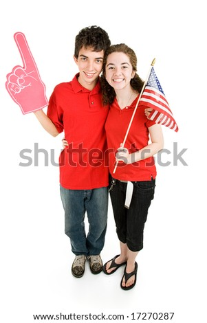 Attractive teen couple supporting their favorite sports team or political party.  Full body isolated on white. - stock photo