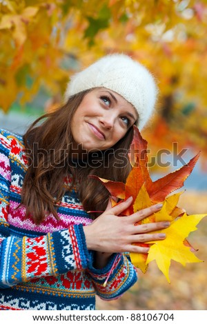attractive teen girl in autumn scene making expression