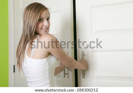 attractive teen girl open closet - stock photo