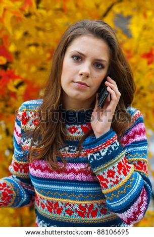 attractive teen girl talking to mobile phone outside