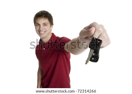 Attractive teenage boy holding car keys isolated on white background - stock photo