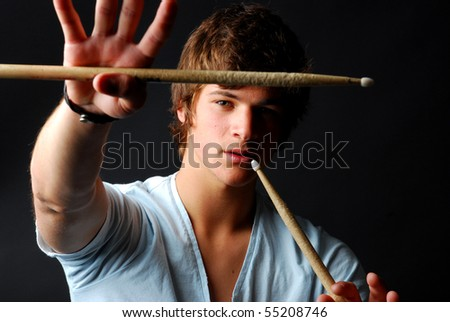 Attractive Teenage Drummer with Drumsticks