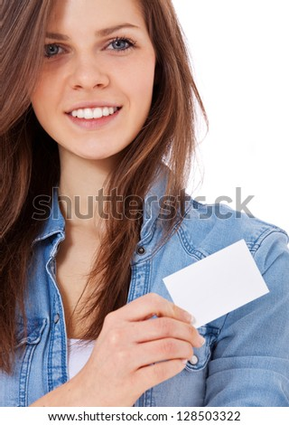 Attractive teenage girl holding blank business card. All on white background.