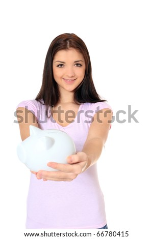 Attractive teenage girl holding piggy bank. All on white background. - stock photo