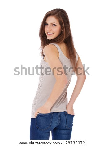 Attractive teenage girl looking over shoulder. All on white background. - stock photo