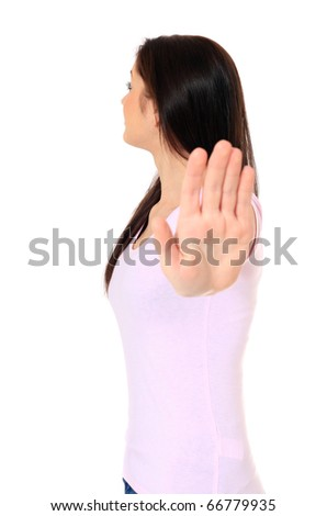 Attractive teenage girl making repelling gesture. All on white background.