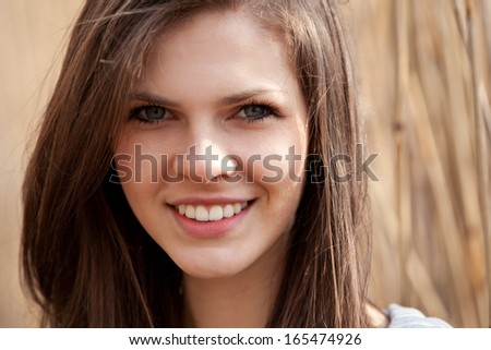 Attractive teenage girl outside - stock photo