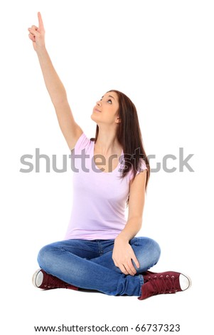 Attractive teenage girl pointing with finger. All on white background. - stock photo
