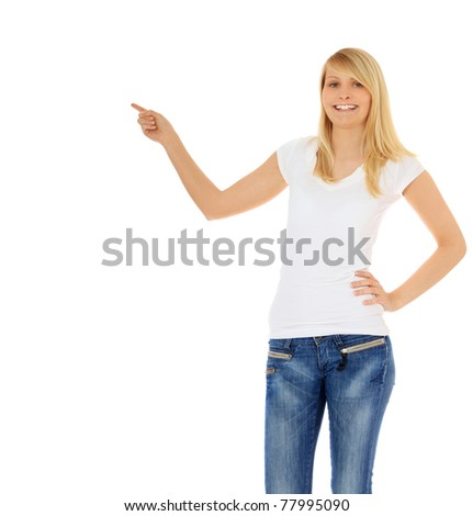 Attractive teenage girl pointing with finger. All on white background.