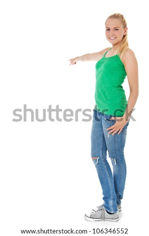 Attractive teenage girl points to the side. All on white background. - stock photo