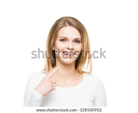 Attractive teenage girl smiling in dental braces. Stomatology concept. - stock photo