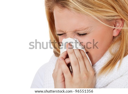 Attractive teenage girl using tissue. All on white background.