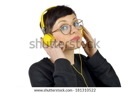 Attractive teenage girl with headphones on white background