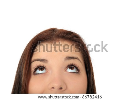 Attractive teenage girls eyes looking to the top. All on white background. - stock photo