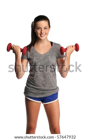 Attractive teenager lifting weights