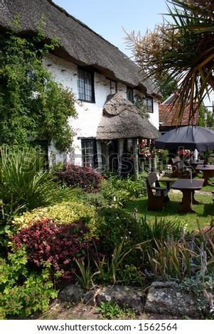 Attractive thatched Devon pub with garden - stock photo