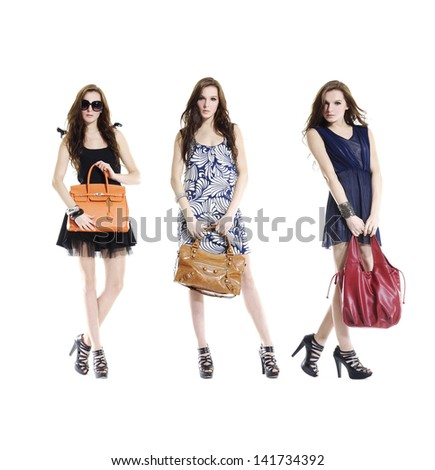 Attractive three young woman with bag standing on a white background - stock photo