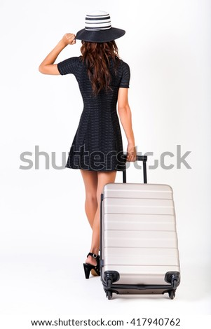 Attractive tourist woman with suitcase on isolated white background - travel and vacation concept - stock photo