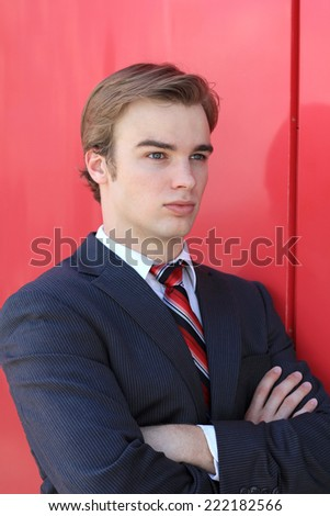 Attractive Upset Blonde Business Professional Business Man Arms Crossed - stock photo