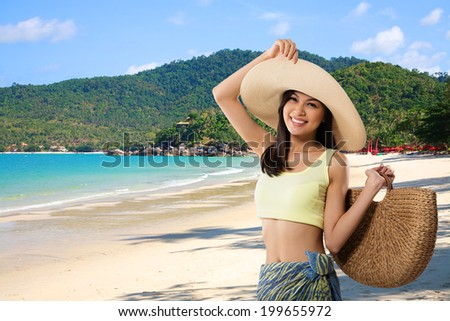 Attractive Vietnamese woman posing against the beautiful tropical background - stock photo