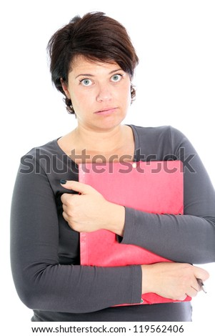 Attractive vivacious woman with a brown envelope in her hands giving a thumbs up gesture  success and victory - stock photo