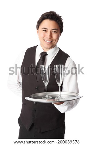 Attractive waiter with 2 empty champagne glasses. Wearing a white shirt and vest. White background. - stock photo