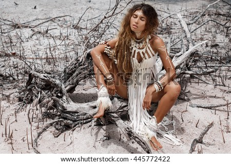 Attractive wild boho woman at beach. Native american style