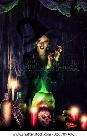 Attractive witch conjures in the wizarding lair. Fairytales. Halloween. - stock photo