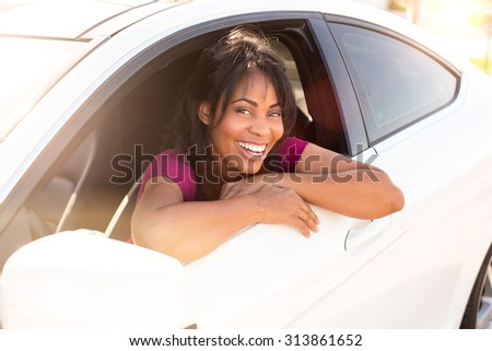 Attractive woman and her white car - stock photo