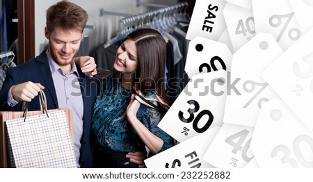 Attractive woman and young man go shopping at the store on sale - stock photo