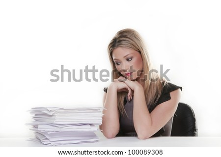 attractive woman at her desk with a lot of paper work to do