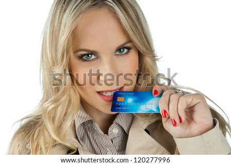 attractive woman biting golden credit card - stock photo