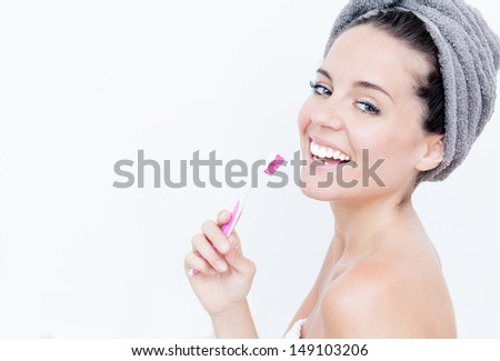 attractive woman brushing her teeth - stock photo