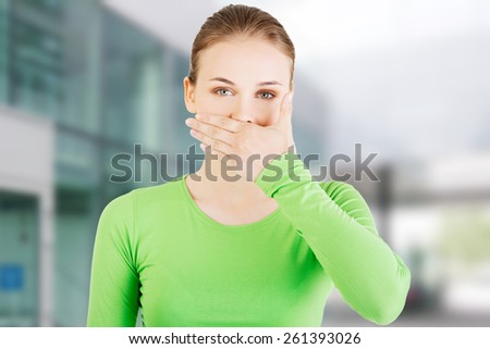 Attractive woman covering her mouth - stock photo
